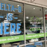 Storefront sign that says Delta-8 Is Here